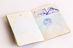 Visas and stamps in passport Royalty Free Stock Images