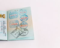Visas and stamps in passport. Visa and customs stamps in passports Stock Photo