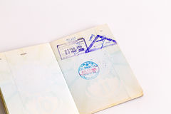 Visas and stamps in passport Stock Images