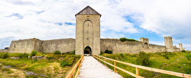 Visby City Wall. Turreted city wall Visby Sweden, Gotland with walkway to entrance Royalty Free Stock Photo