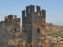 Visconti Castle in Castell`Arquato. Visconti Castle was the seat of the Visconti garrison and has a quadrangular plan with four towers, a mastio and a ditch stock photo