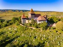 Viscri在Viscri村庄加强了中世纪撒克逊人的教会, 图库摄影