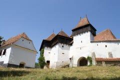 Viscri筑了堡垒于教会, Transylvania,罗马尼亚 免版税图库摄影