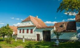 Viscri-Dorf und Wehrkirche von Viscri, Siebenbürgen, ROM Lizenzfreie Stockfotos