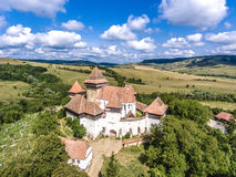 Viscri fortified Church in Transylvania Romania. Viscri fortified Church in the middle of Transylvania, Romania. Aerial view from drone. Important tourist royalty free stock image