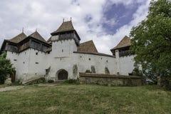 Viscri, Roumanie, l'Europe, église enrichie image libre de droits