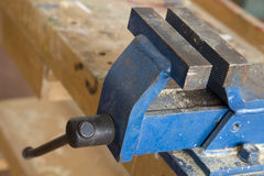Vise. A blue colored vise in a workshop Royalty Free Stock Image