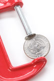 Vise Grip and coin Royalty Free Stock Photography