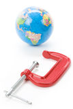 Vise Grip and Earth. Concept of environment and resource issue Royalty Free Stock Photos