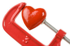 Vise Grip and red heart. Concept of stress, sadness, heart broken, Pain Royalty Free Stock Photos
