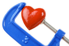 Vise Grip and red heart. Concept of stress, sadness, heart broken, Pain Royalty Free Stock Photo