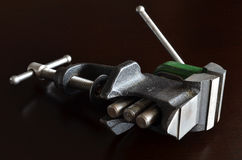 Vise for jewelry work. On a dark background Stock Photography