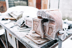 Vise stand on table covered with snow royalty free stock photos