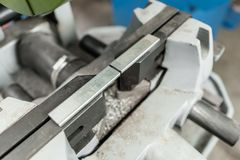 Vise to secure the workpiece. Circular saw machine. Cutting a metal and steel with with sharp, circular blade in. Circular saw machine. Cutting a metal and steel stock photography