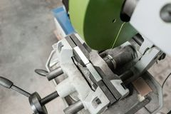 Vise to secure the workpiece. Circular saw machine. Cutting a metal and steel with with sharp, circular blade in. Circular saw machine. Cutting a metal and steel stock photo