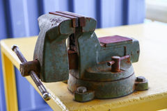 Vise tool in workshop or the garage for support hard work, Special tools for industry job, vise stand on the table with other Royalty Free Stock Image