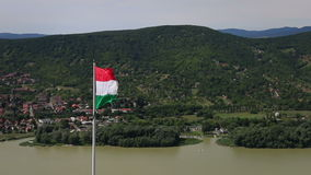 VISEGRAD, HUNGARY - AUGUST 12, 2017: - Hungarian flag waving in the wind stock video