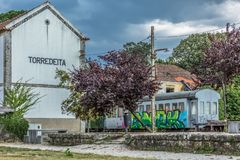 View of a abandoned train station, building and older rustic train, wagon with graffiti street art. Viseu / Portugal - 10/02/2018 : View of a abandoned train stock images