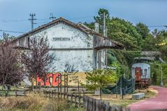 View of a abandoned train station, building and older rustic train, wagon with graffiti street art. Viseu / Portugal - 10/02/2018 : View of a abandoned train royalty free stock image