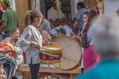 Young people giving concert in medieval fair, playing drums in the streets, cultural event royalty free stock photography