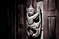 Vishnu garuda statue on wooden wall Royalty Free Stock Photography