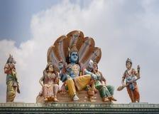 Vishnu, Lakshmi and Bhu under Shesha cobra. Stock Photo