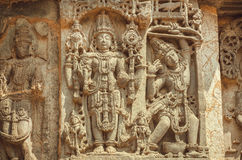 Vishnu Lord on wall of Indian temple. Example of ancient architecture, 12th century decoration, India. Stock Photo