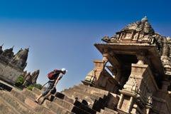 Vishvanatha Temple, Khajuraho, India. Khajuraho, Madhya Pradesh , India - March 2011 :  Foreign visitor at Vishvanatha Temple, dedicated to Lord Vishnu, Western Royalty Free Stock Images
