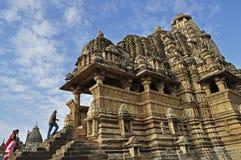 Vishvanatha Temple, Western Temples of Khajuraho,. KHAJURAHO, MADHYA PRADESH, INDIA - MARCH 2011, An Indian family visiting Vishvanatha Temple, dedicated to Royalty Free Stock Photos
