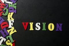 Visión de la palabra en letra de madera colorida del ABC Imagen de archivo libre de regalías