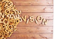 Visión de la palabra hecha con las letras de madera Imagenes de archivo