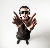 Visión desde el top - DJ - golpeador en una camiseta elegante con el headph Foto de archivo libre de regalías