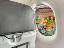 Visión desde la ventana del aeroplano para ver tiempo de la Navidad Imagenes de archivo