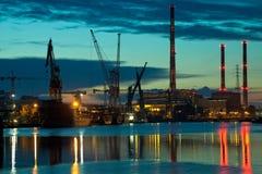 Visión industrial en la puesta del sol Foto de archivo