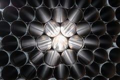 Visión a través de una pila de tubos de acero Imágenes de archivo libres de regalías