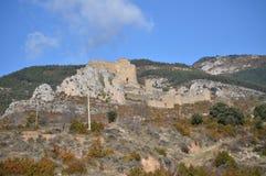 Visiónes desde el pueblo de Riglos de Roman Castle Of Loarre Dating a partir del siglo XI que fue construido por rey Sancho III A foto de archivo libre de regalías