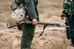 Soldier of the Wehrmacht with a rifle in full gear royalty free stock photo