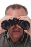 Visible Eyes In Binoculars. Man looking through binoculars with eyes visible in lens; isolated on white with focus on end of binoculars; see two other versions Stock Images