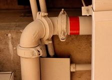 The visible piping. Visible piping and plumbing royalty free stock photo