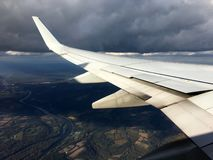 Visible through the window of a flying airplane. stock image