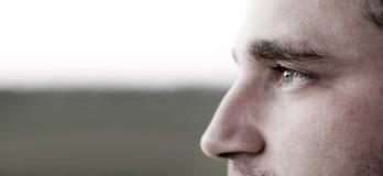 Vision. Man looking far away, low saturation, cool tones Stock Photos
