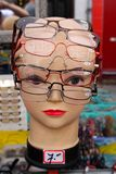 Vision. Model female head with many pairs of spectacles on it Royalty Free Stock Photos