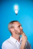Vision. Man wih a beard with a light bulb stock photo