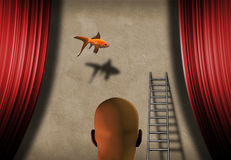 Vision. Surreal dream where fish floats on stage Stock Image