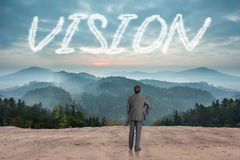 Vision against scenic countryside with mountains Royalty Free Stock Photography