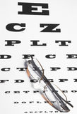 Vision Care. Concept - a pair of glasses and eye chart Royalty Free Stock Image