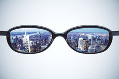 Vision concept with eyeglasses and night city view Stock Images