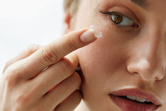 Vision Contact Lenses. Closeup With Beautiful Woman Face. Contact Lens For Vision. Closeup Of Female Face With Applying Contact Lens On Her Brown Eyes. Beautiful Stock Images