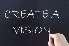 Vision. Create a vision handwritten on a chalkboard Royalty Free Stock Photo