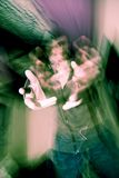 Vision distorted by drinking. A blurred and distorted view of a person reaching out with their hands as seen by a drunk or intoxicated person Royalty Free Stock Images
